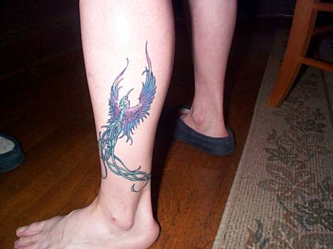 This bird wraps allthe way around her ankle and was done for Wrap around ankle tattoos